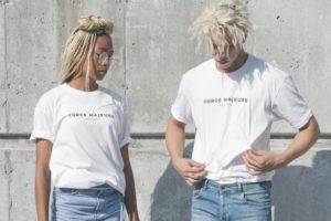 Two people wearing promotional t-shirts