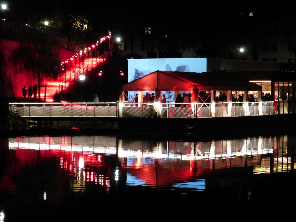 Night time event on a pier under a tent