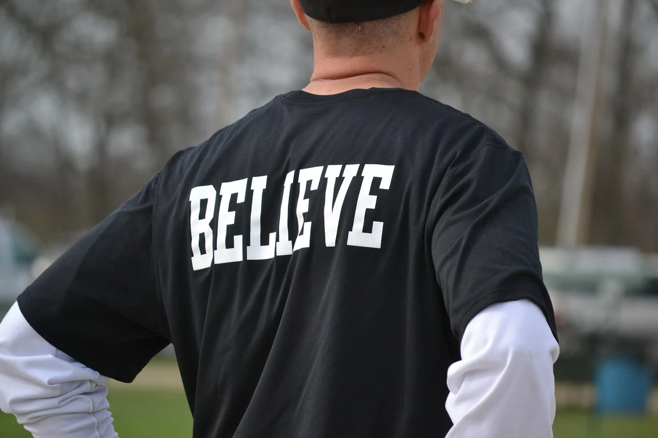 A man with a t-shirt that says Believe