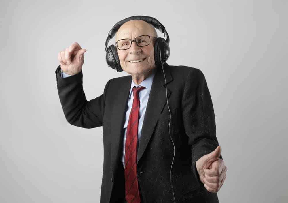 a man listening to music and dancing