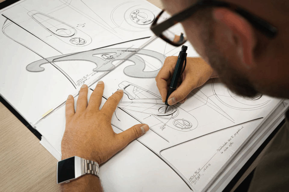 A product designer drawing product plans