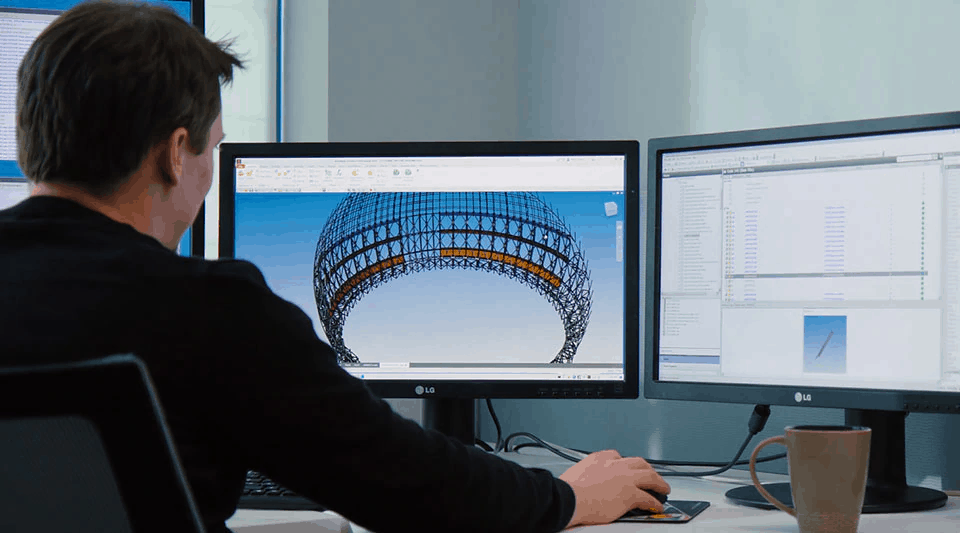 A product designer working on a computer