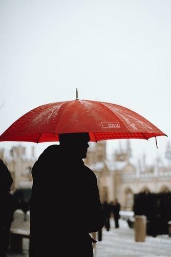 man holding promo gift umbrella
