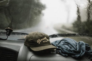 branded hat on dashboard